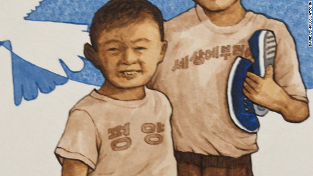 "Like most North Korean families, Song's parents didn't want him to wear his shoes unless it was necessary. ""Shoes cost parents three or four days' wages,"" Song said, ""and children were expected to stitch their own repairs."" In ""Barefoot Boys,"" a T-shirt says ""Nothing to Envy in the World."""