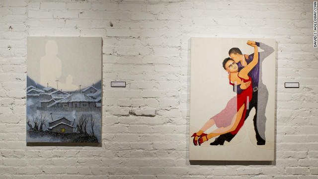 "In ""Hillside Slums,"" the painting on the left, an image of Song's mother dominates the skyline over the house he grew up in. She told Song she was worried about Kim Jong Il's health before she herself died in the famine of the 1990s. By putting Kim in drag in ""Fall Into My Arms,"" Song glamorizes all things foreign and wonders whether life would not be more exciting for North Korea if it was opened to the outside."