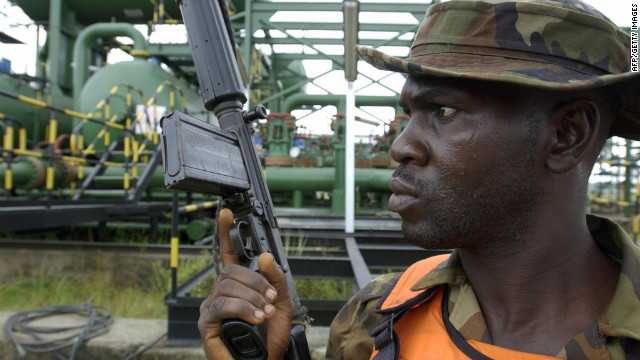 A Nigerian soldier stands guard at an oil flow station in the western Niger Delta in 2003. 
