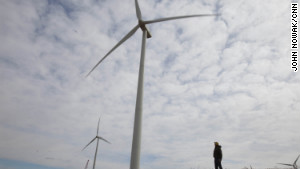Dean Tofteland checks out a wind turbine in southwestern Minnesota. 