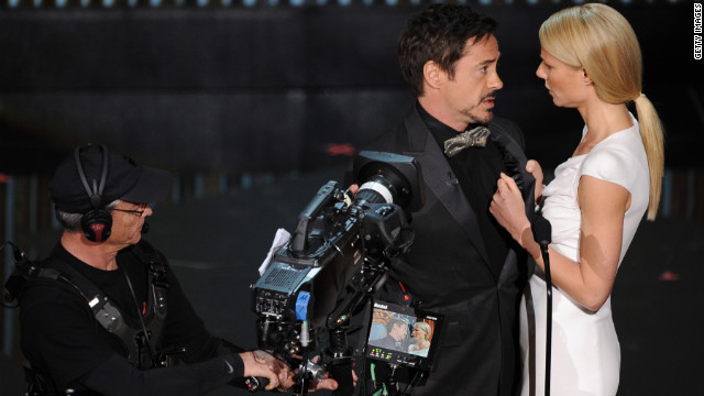 "Robert Downey Jr. and his film crew joined Gwyneth Paltrow on stage to present the award for best documentary feature. Downey said he was starring in a documentary film called ""The Presenter."" He explained, ""Plural titles are out this year"" -- sorry, Gwyneth. ""Undefeated,"" a film with a singular title, won the award."