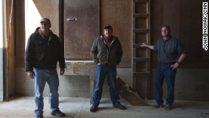 Dean Tofteland, center, with Brad and Mike Mouw at their grain shop in Leota, Minnesota. 