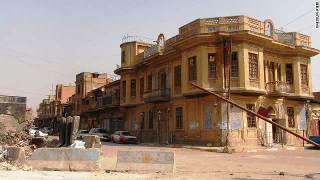 A typical 1930s house in the Rusafa district of Baghdad, with concrete blocks used to divide neighborhoods with the aim of reducing sectarian violence. Photo taken in 2011.