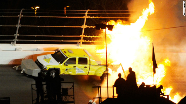The race was delayed further when Colombian driver Juan Pablo Montoya crashed into one of the jet dryers which was drying the track, causing the car and the truck towing it to burst into flames.