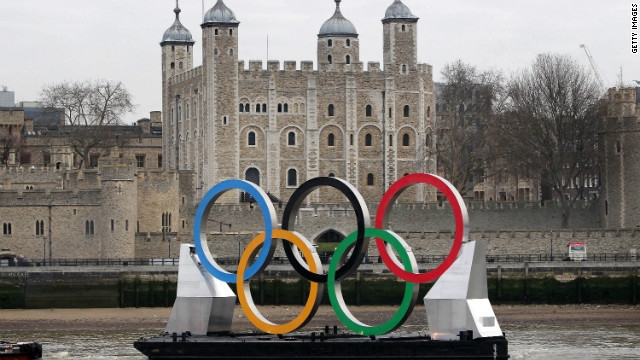 Giant Olympic rings are towed on the River Thames in front of the city's iconic Tower of London on February 28, 2012.