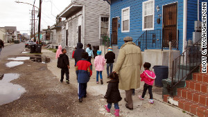 Darryl Durham, head of Anna\'s Arts for Kids, walks with several children through the Treme neighborhood.