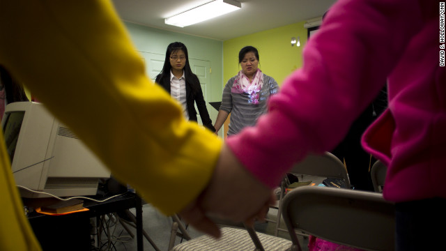 Han's two daughters, EunHye, 20, and JinHye, 24, pray at the Pilgrim Community Church in Virginia. In 1998, the sisters, severely malnourished, walked for three days and crossed the Tumen River to escape into China. They had to leave their younger brother behind in North Korea.<br/><br/>