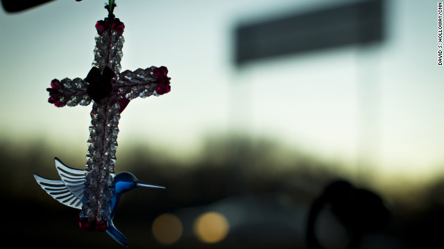 A beaded cross dangles from the rearview mirror of JinHye's car. She made all the crosses so she could sell them to help North Korean refugee efforts.