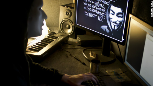 A masked member of 'Anonymous' hacks the French presidential Elysee Palace website in this photo dated January 20, 2012.