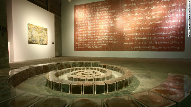On show at Edge of Arabia (on the back wall), the artwork is made from 3,000 plastic cap gun discs. Mater says people in Saudi are afraid to talk, but adds that freer expression should come as part of a gradual change.