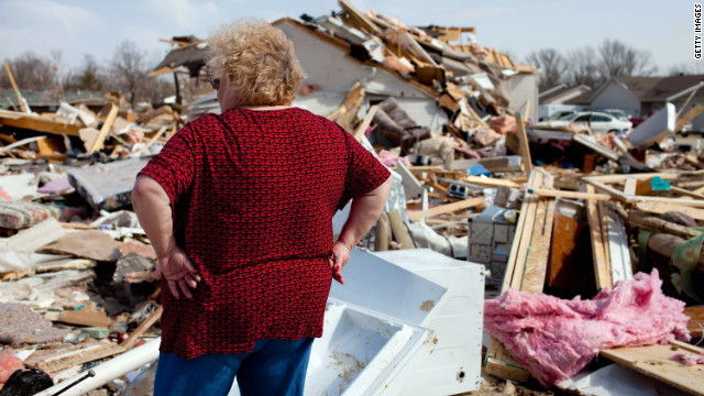 Carolyn Osman surveys the wreckage of the tornado that took her mother-in-law's life in Harrisburg, where some 100 people were also injured.