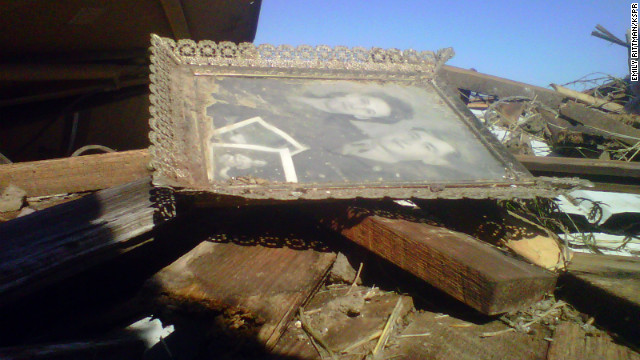 An old family photo survives the destruction in Buffalo, Missouri.