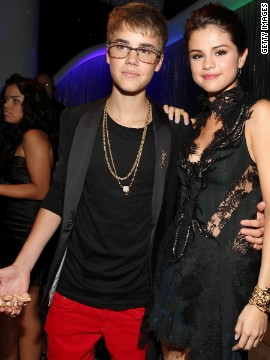 "Bieber attends the MTV Video Music Awards in August 2011 with a snake on one hand and then-girlfriend Selena Gomez holding on to the other. He won the best male video award for ""U Smile"" that night."