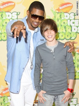 "At 15, Bieber had yet to become synonymous with the ubiquitous single ""Baby."" At this point, he was soaking up all he could learn from his mentor, Usher, with whom he attended the Nickelodeon Kids' Choice Awards in March 2009."