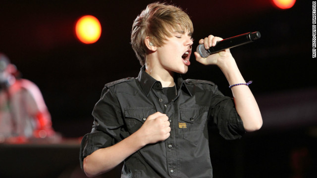 "By early 2010, Bieber had notched a chart-scaling album with ""My World"" and was ready to release ""My World 2.0,"" which contained the single ""Baby."" Here, Bieber performs at the Pepsi Super Bowl Fan Jam in Miami Beach in February 2010."