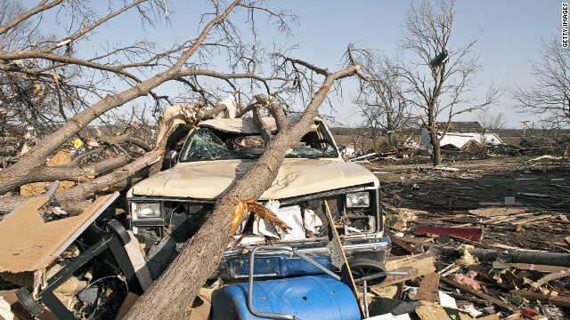Downed trees crush a truck Wednesday after a tornado hit in Harveyville, Kansas. A state of emergency was declared in the town about 20 miles southwest of Topeka.