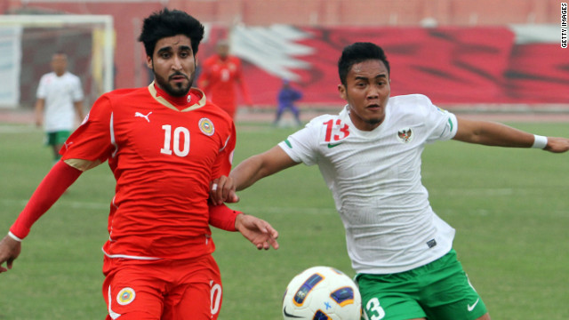Bahrain's Mohammed Ali (left) battles for the ball with Indonesia's Guvan Dwicahyo during Wednesday's match.