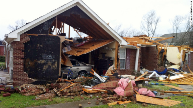 A tornado touched down in Madison County, Alabama, on Friday, causing widespread damage. The powerful storm system is moving across the United States, causing tornadoes from Alabama to Indiana and threatening more destruction. In Indiana, at least five deaths were reported.