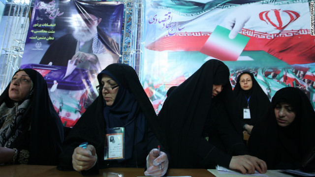 Electoral staff registers voters at a polling station in Tehran on March 2.