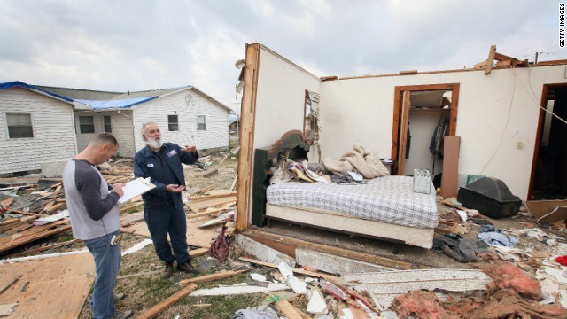 Keith Huke, right, remained in the bed to his left, escaping with no injuries from the tornado that tore apart his home in Harrisburg, Illinois.<br/><br/> <br/><br/>