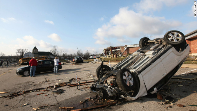 A car and school bus are overturned in the parking lot of a Henryville school.