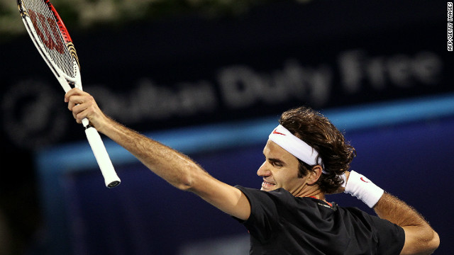 Roger Federer punches the air after beating Scotland's Andy Murray in the final of the Dubai Open on Saturday