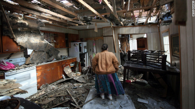Leah Boylan looks at the damage to her sister's home on Saturday, March 3, after it was destroyed by a tornado in Henryville, Indiana. Dozens of people were killed as severe weather and tornadoes ripped through the South and Midwest on Friday, March 2.