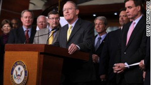 Republican Sen. Lamar Alexander, center, and Democratic Sen. Mark Warner, right foreground, are hosting a series of bipartisan dinners for fellow senators.
