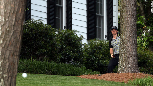 Masters disaster. McIlroy chips out from the trees on the 10th hole during the final round of the 2011 Masters at Augusta National Golf Club. He sqaundered a four-shot lead in the final round to eventually finish in a tie for 15th. 