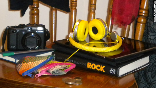 Heaphones, camera, a second purse for foreign currency and a book -- some of Ayesha Durgahee's travel essentials.