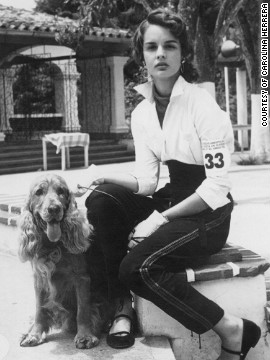 Carolina Herrera, aged 16, with her cocker spaniel, Red, at a dog show in Caracas, Venezuela. She says she was more interested in horses than fashion as a child, but was always surrounded by beautifully dressed women.
