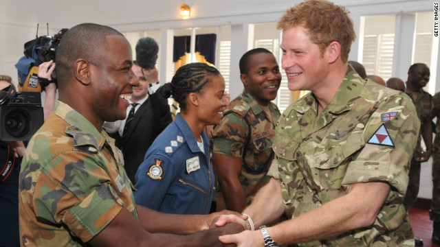Prince Harry meets fellow Sandhurst graduate Lieutenant Kayon Mills in Jamaica.