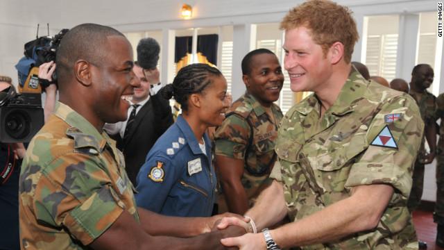 Prince Harry meets fellow Sandhurst graduate Lieutenant Kayon Mills in Jamaica.