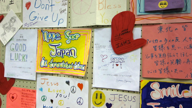 """During the """"Words of Hope for Japan"""" campaign launched by Kathleen Koch, hundreds of volunteers translated thousands of letters sent to earthquake and tsunami victims in Japan. This bulletin board full of letters was posted at a surprise concert at a school turned shelter in Minamisoma, Japan."""