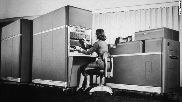 A woman operates one of the early desktop IBM computers in this photo from 1955. Today, desktop and laptop computers are on the decline as consumers flock toward tablet devices. Dell's first quarter profit plunged 79% because of slower PC sales.