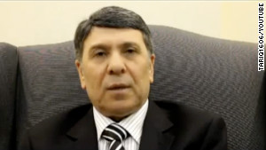 A man identifying himself as Syria\'s deputy oil minister, Abdo Hussam el Din, said in a YouTube video he was defecting.