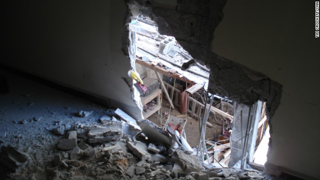 A hole blown in side of a house used by the media in Homs, Syria.
