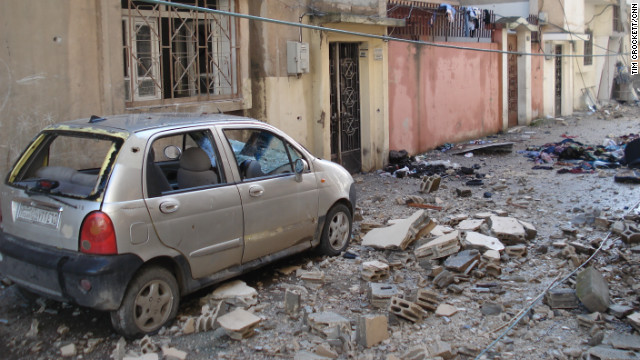 A bombed out car and rubble covers the ground in this street Homs, Syria, where the army has been attacking anti-regime elements.