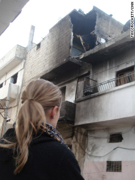 CNN correspondent Arwa Damon walks through battered and defiant Homs, Syria.