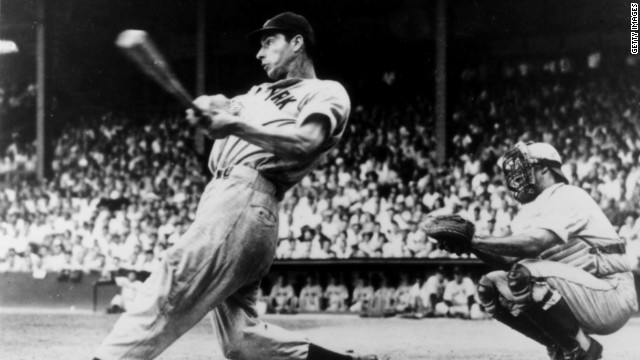 New York Yankees slugger Joe DiMaggio follows through on a swing in the mid-1940s, an era when baseball had 16 teams.