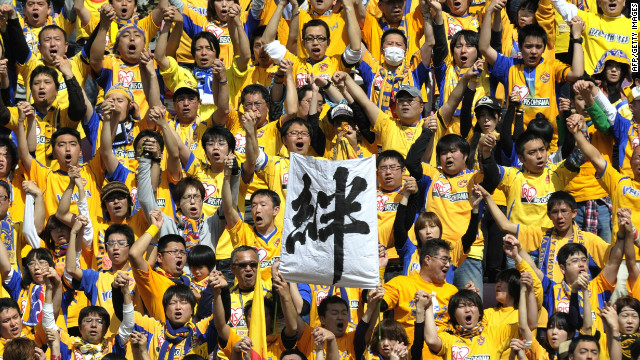 Vegalta Sendai's fans hold up a banner reading