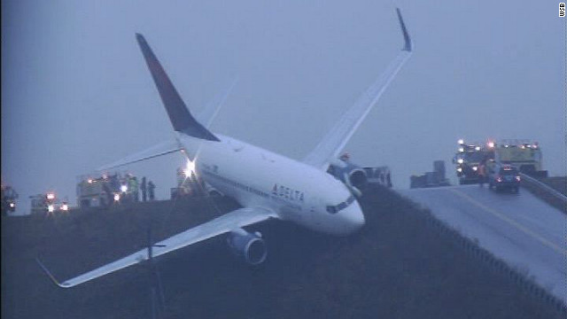 Delta jetliner rolls off taxiway during test