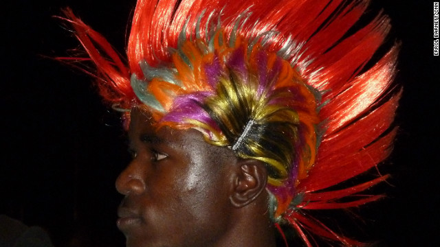 A young man stands out in Libreville during a concert.