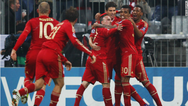 Bayern Munich players celebrate a hat-trick for Mario Gomez in the Allianz Arena.