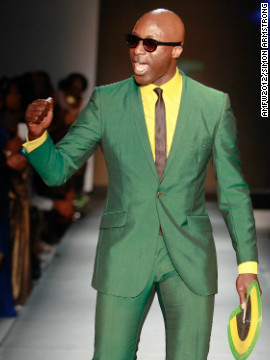 Ozwald Boateng, a British designer of Ghanaian descent, takes to the runway in one of his distinctive creations. Boateng was presented the 