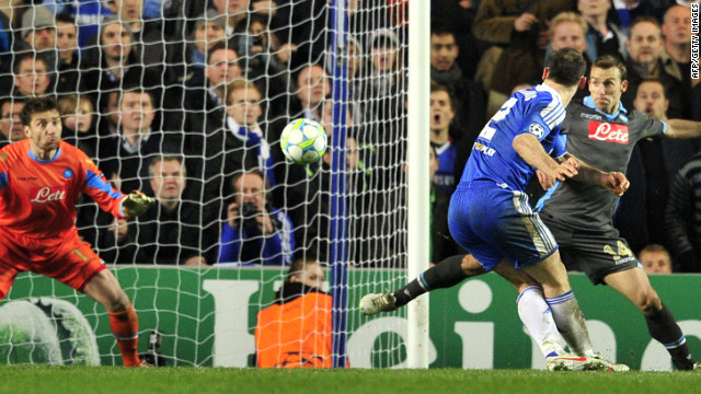 Branislav Ivanovic strikes home Chelsea's clinching goal against Napoli in their last 16 Champions League tie.