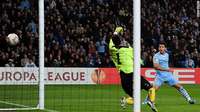 Sergio Aguero fires home Manchester City's third goal against Sporting Lisbon in the last-16 Europa League tie at the Etihad Stadium. A valiant second-half comeback wasn't enough to send City crashing out on the away goals rule. 