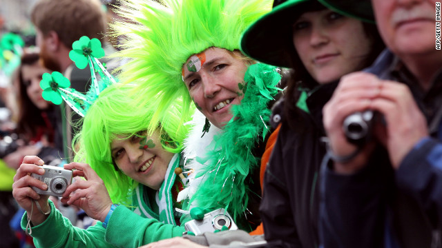 "Parade-goers dress up for the occasion. The Irish blessing says, ""May good luck be with you / Wherever you go / And your blessing outnumber / The shamrocks that grow."""
