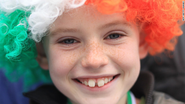 A young boy smiles as he watches the St Patrick's Day festivities in Dublin.