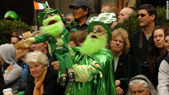 Parade-goers watch the 251st St Patrick's Day Parade up 5th Avenue in New York.